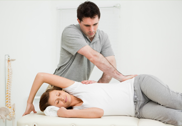 chiropractor helping his patient